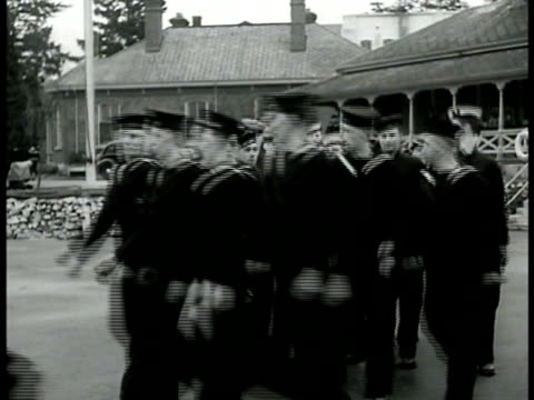 royal navy sailors in uniform marching circlepattern navy sailors around model destroyer one pointing w/ pen at model cu naval teacher hat 'hmcs... - sailor stock videos & royalty-free footage