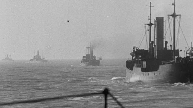 1940 MONTAGE Royal Navy warships protecting convoy at sea, and transport ships unloading at dockside / United Kingdom