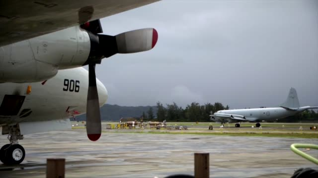 a royal new zealand air force p3k2 arrives at the airfield aboard mcbh during rim of the pacific exercise 2014 the plane joins the multitude of other... - military exercise stock videos and b-roll footage