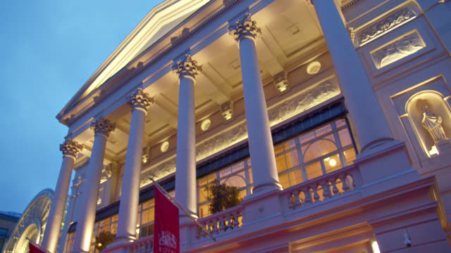 royal opera close up. evening. lit up building. international landmark. - wall building feature stock videos & royalty-free footage