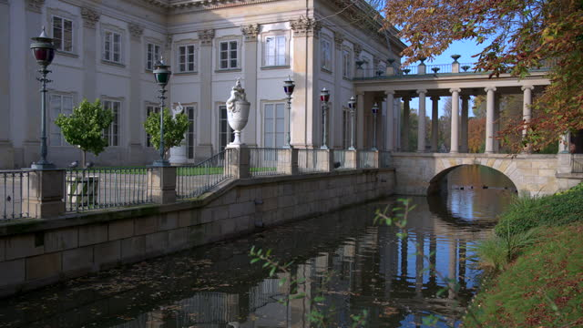 royal palace on the water in lazienki park, warsaw - eastern european culture stock videos & royalty-free footage