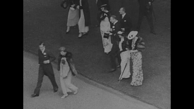 royal party emerging from buckingham palace / prince george, duke of kent, and duchess of kent, princess marina walk across lawn as they arrive at... - king royal person stock videos & royalty-free footage