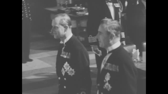 royal party walks in the painted hall of the royal naval college on trafalgar day in london / queen elizabeth ii walks with first lord of the... - state dinner stock videos & royalty-free footage