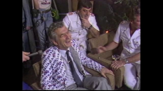 celebrating supporters man shakes and sprays champagne / prime minister bob hawke into crowded celebrating room sprayed with champagne laughs and... - bob hawke stock videos and b-roll footage