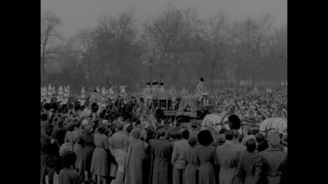 royal procession leaves grounds of buckingham palace for the palace of westminster for the first state opening of parliament of queen elizabeth ii's... - 1952 stock videos and b-roll footage