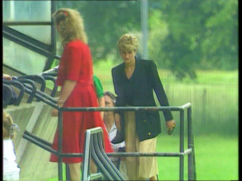 vídeos de stock, filmes e b-roll de what about the children royal separation what about the children seq diana with william and nanny up steps in sports arena tx - 1992