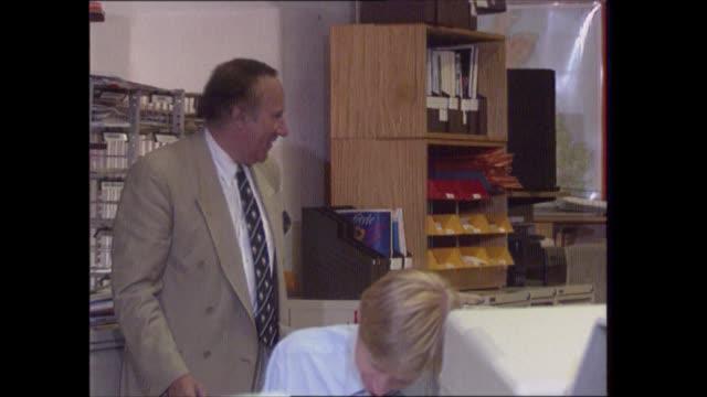 'diana: end of a fairytale?'; england: int andrew neil working in office - andrew neil bildbanksvideor och videomaterial från bakom kulisserna