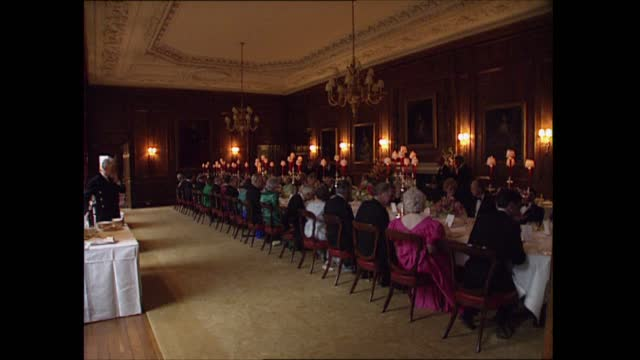 the royal family in scotland; scotland: edinburgh: palace of holyroodhouse : ext holyrood palace int various of guests arriving for dinner party... - tracking shot stock videos & royalty-free footage