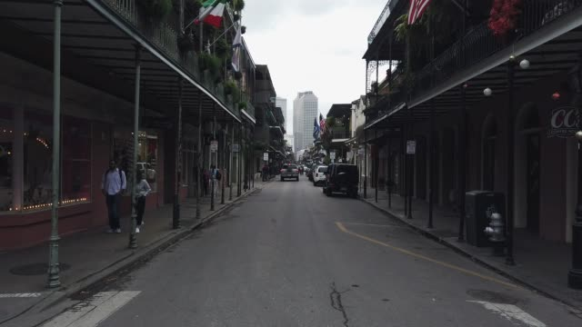 royal street (shops and bars) in the french quarter of new orleans during the day - bourbon street new orleans stock videos and b-roll footage