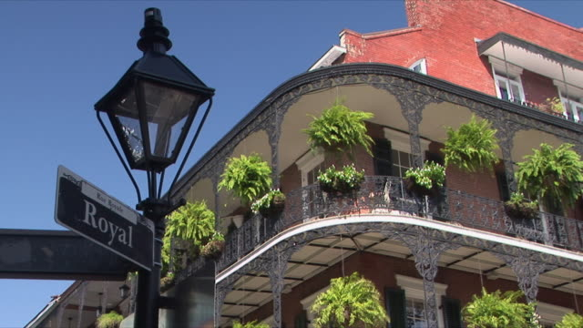 ms la royal street sign and balcony with potted plants, french quarter, new orleans, louisiana, usa - new orleans stock videos and b-roll footage