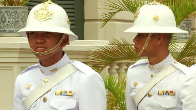 ms pan zo royal thai guards standing by grand palace / bangkok, thailand - honour guard stock videos & royalty-free footage