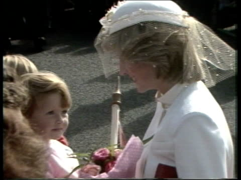 Day 12 TASMANIA Ross TS Prince Charles and the Princess of Wales out of car in village ZOOM IN as children rush forward to present flowers CS...