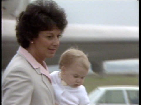 royal tour day 29 new zealand auckland ms prince charles and princess diana down plane steps ms prince william carried by nanny barbara barnes down... - 1983 stock videos & royalty-free footage