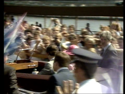vídeos de stock e filmes b-roll de day 9 australia sydney opera house gv vast crowd outside opera house pan lr lms motorcade towards cms man in crowd cms lady with union jack hat on bv... - 1983