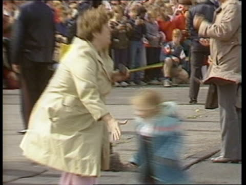 the queen in canada:; tx:27.9.84 canada: cornwall: civic centre: ext seq guard adjusts awning on train; queen elizabeth ii and prince philip, duke of... - bagpipes stock videos & royalty-free footage