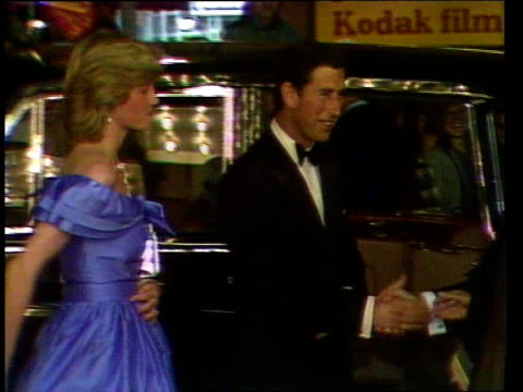 vídeos de stock e filmes b-roll de royal tour special week 5 ms crowds as royal car arrives and couple out and greeted diana given flowers ms royal party walk up stairs lms coppelia... - princesa