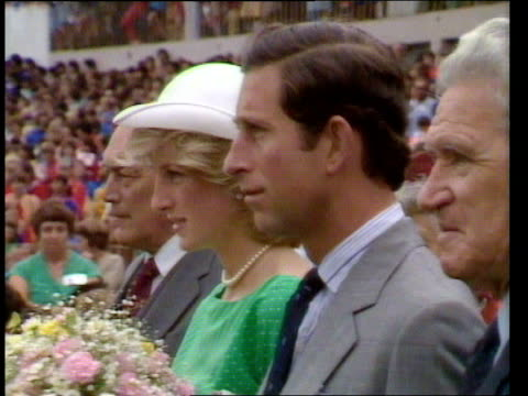 Royal tour special Week 5 NEW ZEALAND Auckland Eden Park MS Mass children waving ZOOM Prince and Princess of Wales driven round in car MS Children...