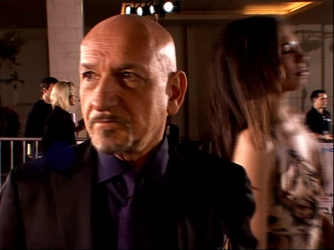 royal variety club showbiz awards: red carpet arrivals; back view sir ben kingsley being interviewed on red carpet with his wife lady daniela barbosa... - 俳優 マイケル・ケイン点の映像素材/bロール