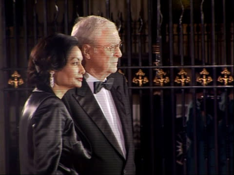 royal variety club showbiz awards: red carpet arrivals; sir michael caine and wife shakira baksh arriving, posing for photocall / back view caine and... - 俳優 マイケル・ケイン点の映像素材/bロール