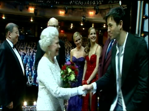 Queen and Prince Philip arrival Cast members and audience applaud as Queen and Prince Philip along on stage meeting performers in the show including...