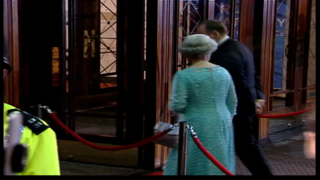 royal variety show; england: london: ext at night tms queen elizabeth ii arriving at royal variety performance pull out as along red carpet jennifer... - queen royal person stock videos & royalty-free footage