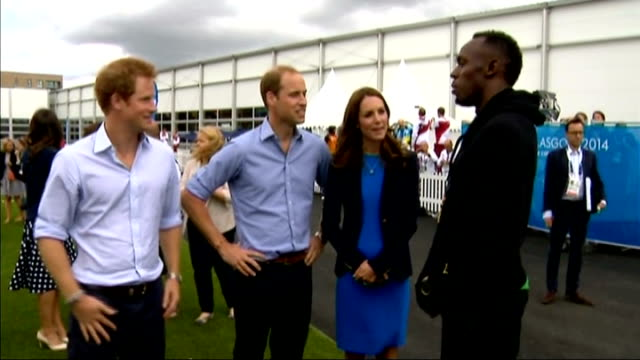 Royal visit SCOTLAND Glasgow Athletes Village EXT Prince Harry Prince William and Catherine Duchess of Cambridge chatting to sprinter Usain Bolt Kate...