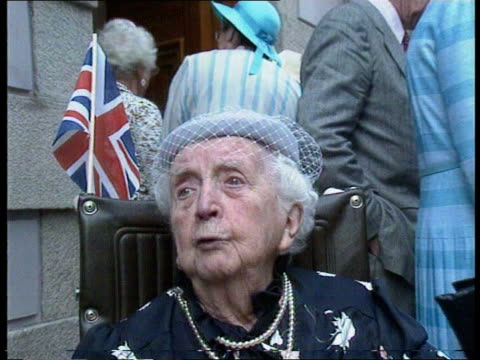 day 3 **** rushes kept channel island jersey st helier tms queen elizabeth wearing blue dress amp hat with white shoes amp bag on walkaboutk tcms... - the queen stock videos and b-roll footage