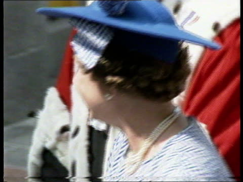 royal visit to channel islands: day 3; rushes not kept: channel island, jersey, st helier tms queen elizabeth wearing blue dress & hat with white... - 3日目点の映像素材/bロール