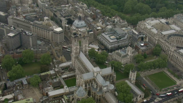 stockvideo's en b-roll-footage met air views of westminster abbey and buckingham palace; air view westminster abbey zoom in fans of royal family camping out in tents on pavement lining... - westminster abbey