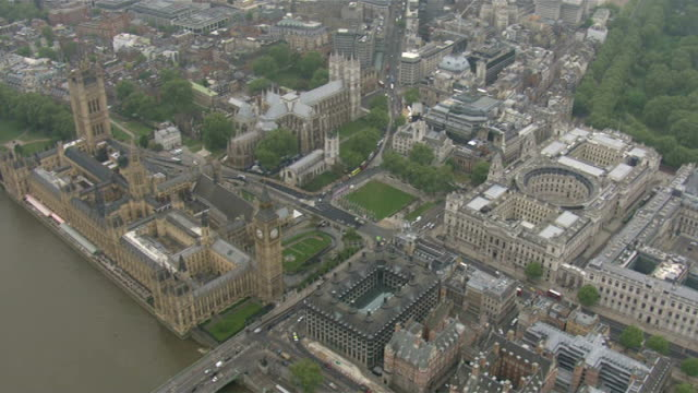 air views of westminster abbey and buckingham palace; england: london: westminster: ext air view westminster abbey zoom in then pull out / air view... - royalty stock videos & royalty-free footage