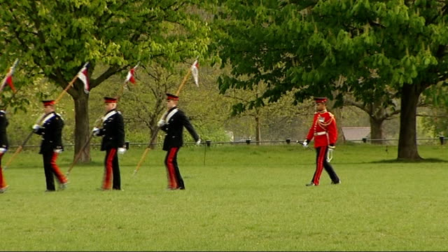 Ceremonial manoeuvres by Household Cavalry ENGLAND London Hyde Park EXT Members of the Household Cavalry marching along carrying pennants