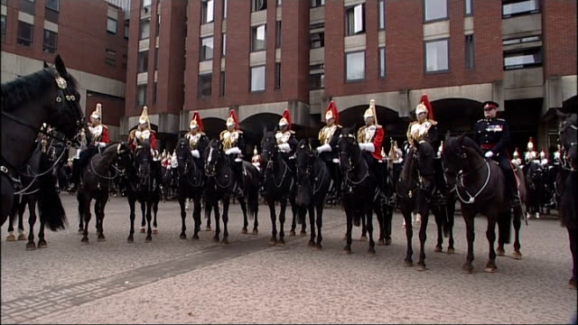 Ceremonial manoeuvres by Household Cavalry More GVs of Household Cavalry carrying out their practice session as front row of horses walk away GV...