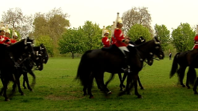 Ceremonial manoeuvres by Household Cavalry Mounted military band riding along in silence / Household Cavalry regiment in ceremonial uniforms riding...