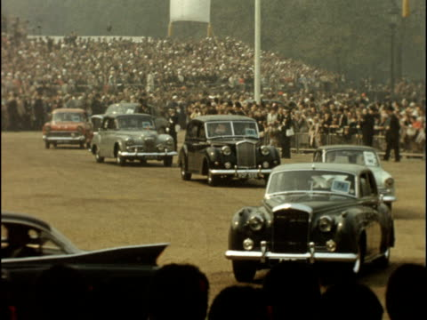 stockvideo's en b-roll-footage met colour footage of princess margaret's wedding to antony armstrong jones crowd seen from above crowd lining pavement in parliament square banner with... - prinses margaret windsor gravin van snowdon