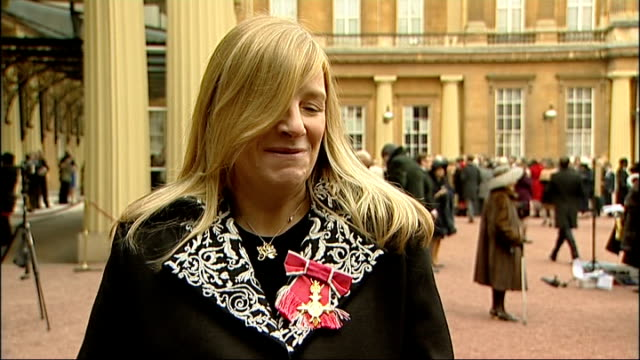 royal wedding dress fashion designer sarah burton awarded obe ext sarah burton interview sot sarah burton posing with obe outside palace - order of the british empire stock videos and b-roll footage