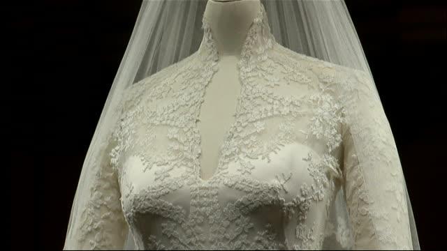 Royal wedding dress fashion designer Sarah Burton awarded OBE LIB 2072011 INT Wedding dress worn by Duchess of Cambridge on display