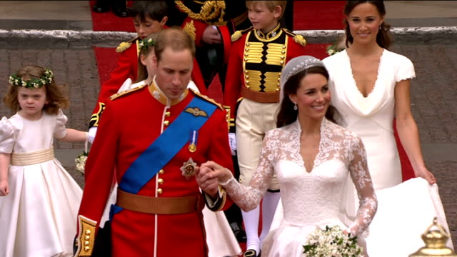 royal wedding dress fashion designer sarah burton awarded obe lib catherine duchess of cambridge and prince william duke of cambridge from church to... - order of the british empire stock videos and b-roll footage