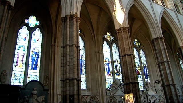 stockvideo's en b-roll-footage met exterior and interior shots of westminster abbey; ornate altar pull out nave with grave of unknown warrior / stained glass windows and pointed gothic... - westminster abbey