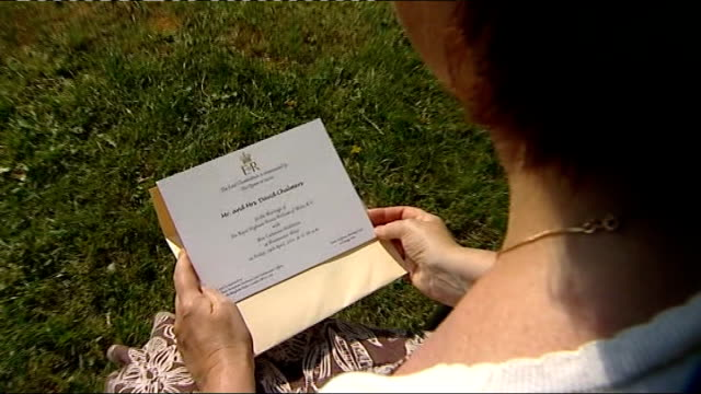 vídeos de stock, filmes e b-roll de guest list revealed ext ann chalmers seated in garden looking at her invitation to royal wedding close shot of ann chalmers' wedding invitation ann... - hóspede