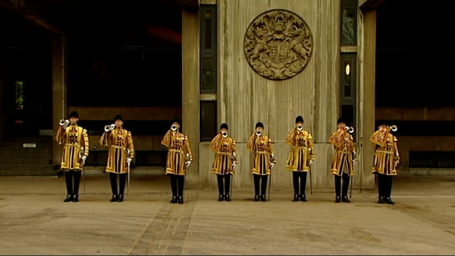 Household Cavalry facility ENGLAND London Hyde Park Barracks EXT GVs State Trumpeters in ceremonial dress lining up and play fanfare SOT Two...