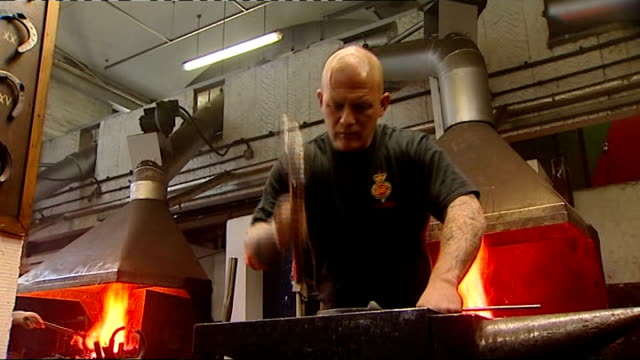 stockvideo's en b-roll-footage met household cavalry preparations at stables furnace used to heat up horseshoes / horseshoe taken from furnace placed on anvil and shaped by blacksmith... - smeden