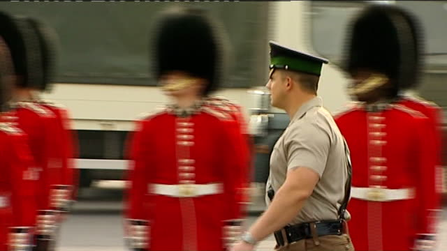 irish guards practice on parade ground england berkshire windsor ext various gvs irish guards marching on parade ground ahead of royal wedding and... - drill instructor stock videos & royalty-free footage