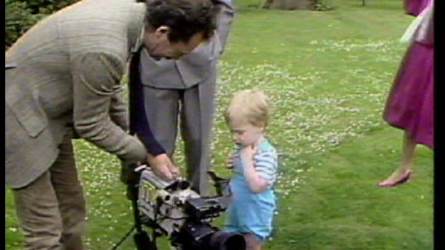 life after the wedding; tx 12.6.1984 / 127613 england: london: kensington palace gardens: ext itn cameraman shows young prince william his camera and... - dungarees stock videos & royalty-free footage