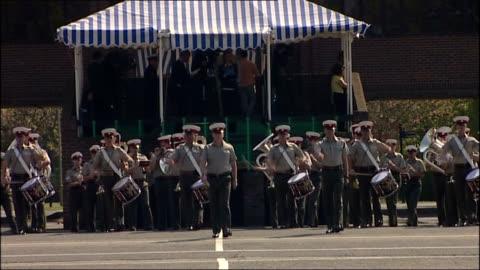 vídeos y material grabado en eventos de stock de military preparations; royal marines bands entering square as playing music sot / military bands along past marquee / various general views of bands... - royal marines
