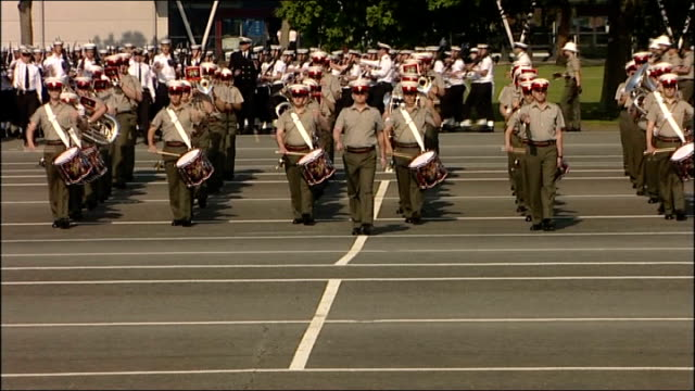 Military preparations Various general views of marching band practice SOT / Navy personnel marching to music of band SOT / Musicians and navy...