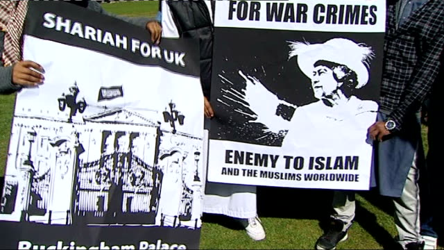 muslim protesters outside parliament; england: london: westminster: ext general views of 'muslims against crusades' protesters holding up banners... - the crusades stock videos & royalty-free footage