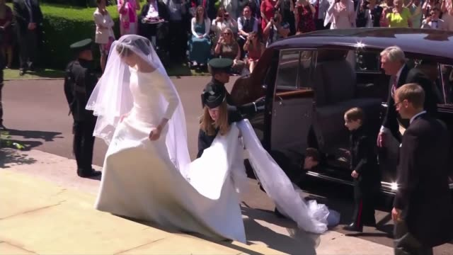 royal wedding of prince harry and meghan markle interview with dress designer clare waight keller ext meghan duchess of sussex from car wearing... - meghan duchess of sussex stock videos and b-roll footage