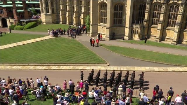 royal wedding of prince harry meghan markle itv news special ceremonial feed 1310 1410 england berkshire windsor windsor castle ext members of the... - サセックス公爵ヘンリー王子点の映像素材/bロール