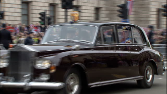 Royal wedding of Prince William and Kate Middleton ITV News Special PAB 1030 1130 EXT State car carrying Prince of Wales and Camilla Duchess of...