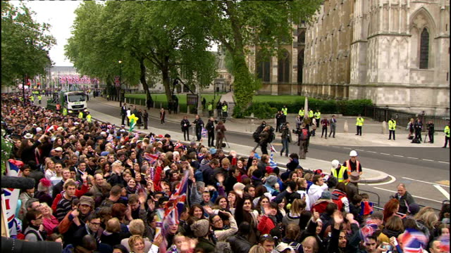 royal wedding of prince william and kate middleton itv news special ceremonial feed 0700 0800 crowd 'welcome to westminster abbey' sign crowds waving... - abbey stock videos & royalty-free footage